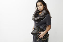 Young woman holding a handbag Royalty Free Stock Photos