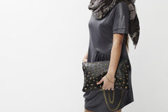 Young woman holding a handbag Stock Photos