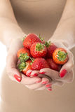 Young Woman Holding Handful of Fresh Strawberries Royalty Free Stock Images