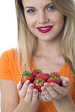 Young Woman Holding a Handful of Strawberries Royalty Free Stock Photos