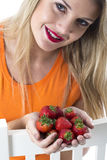 Young Woman Holding a Handful of Strawberries Royalty Free Stock Images