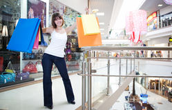 Young woman holding in hands multi-coloured bags Stock Photography