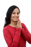 Young woman holding hands in prayer position Royalty Free Stock Photo