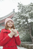 Young Woman Holding hands in snow Royalty Free Stock Photography