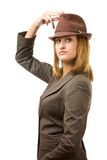 Young woman holding hat and looking at you.  Royalty Free Stock Photos