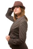 Young woman holding hat and looking at you. Stock Images