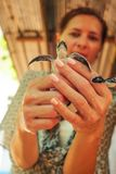 Young woman holding hatched turtle in her hands. Sea Turtle Hatchery Centre, Galle, Sri Lanka stock photos