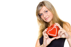 Young woman holding heart Stock Images
