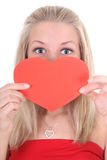 Young woman holding heart card Stock Images