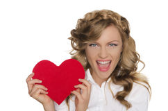 Young woman holding heart next to him Stock Images