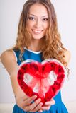Young woman holding heart shaped box royalty free stock photos
