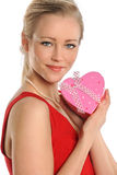 Young Woman Holding Heart Shaped Gift Royalty Free Stock Images