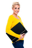 Young Woman Holding her Closed Laptop Stock Photography