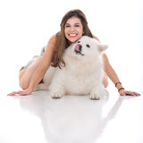 Young woman holding her dog underneath her Stock Photo