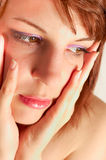 Young woman holding her face Stock Photography