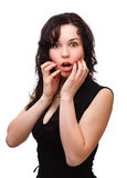 Young woman holding her face in astonishment Stock Images