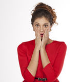 Young woman is holding her face in astonishment Stock Photo
