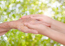 Young woman holding her grandmother hand Royalty Free Stock Photography