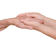 Young woman holding her grandmother hand Royalty Free Stock Images