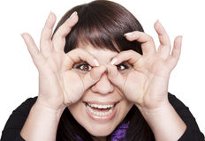 Young woman holding her hands over her eyes as gla. Young happy woman holding her hands over her eyes as glasses stock image