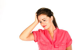 Young woman holding her head and looking down Royalty Free Stock Image