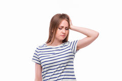 Young woman holding her neck in pain. And discomfort Stock Image