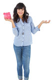 Young woman holding her piggy bank Royalty Free Stock Photo