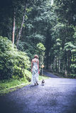 Young woman holding her puppy beagle dog in nature of tropical Bali island, Indonesia. Young woman holding her puppy beagle dog in nature of tropical Bali Stock Photos