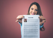 Young woman holding her resume Stock Photos