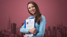 Young woman holding her resume Royalty Free Stock Photos