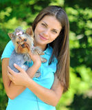Young woman holding her sweet little puppy - outdoor portrait Stock Photos