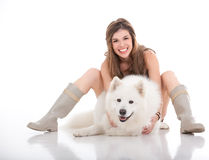 Young woman holding her white dog in front of her Stock Photography