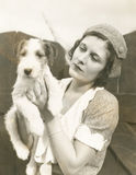 Young woman holding her wire-haired fox terrier Royalty Free Stock Image