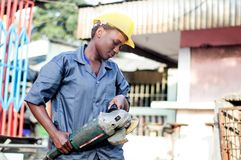 Young woman holding her working tool. Royalty Free Stock Photo