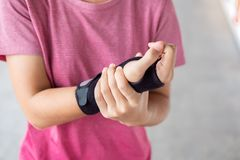 Free Young Woman Holding Her Wrist Pain Because Using Computer Long Time. De Quervain`s Tenosynovitis, Intersection Symptom, Carpal Royalty Free Stock Photo - 156355875