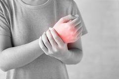 Free Young Woman Holding Her Wrist Pain Because Using Computer Long Time. De Quervain`s Tenosynovitis, Intersection Symptom, Carpal Stock Photos - 156355903