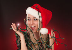 Young woman holding holiday lights Stock Images
