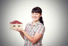 Young woman holding home Stock Images