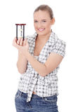 Young woman holding hourglass Royalty Free Stock Photo