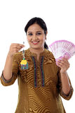 Young woman holding house shape key and 2000 rupee notes Stock Photography