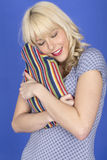 Young Woman Holding and Hugging a Hot Water Bottle Stock Photography