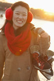 Young Woman Holding Ice Skates in Beijing Royalty Free Stock Photography