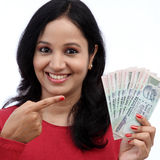 Young woman holding Indian currency Royalty Free Stock Photos