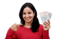 Young woman holding Indian currency Royalty Free Stock Image