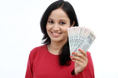 Young woman holding Indian currency Royalty Free Stock Images