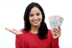 Young woman holding Indian currency Stock Images