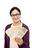Young woman holding Indian rupee bills Stock Photo