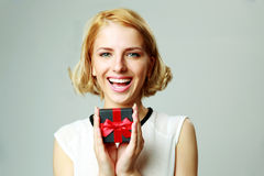 Young woman holding jewelery gift box Stock Photography