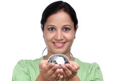 Young woman holding jigsaw puzzle globe Royalty Free Stock Image