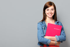 Young woman holding job application. On grey background Royalty Free Stock Image